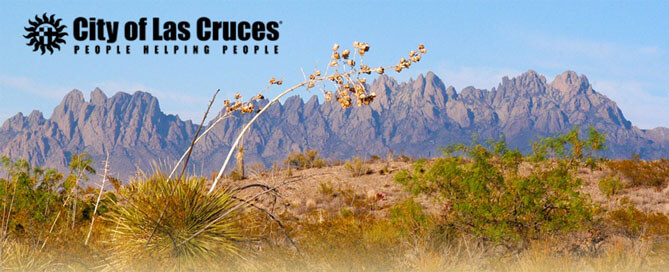 City of Las Cruces - People Helping People logo in front of hill and mountain range